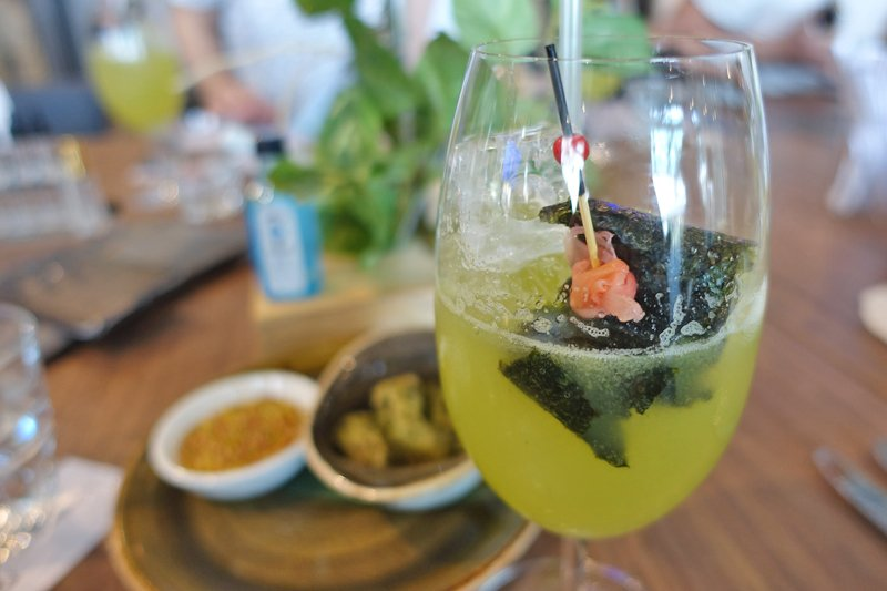 Sipping on the DL in Paradise cocktail by Union Electric with Tempura mussels with salt & vinegar sesame & roasted nori