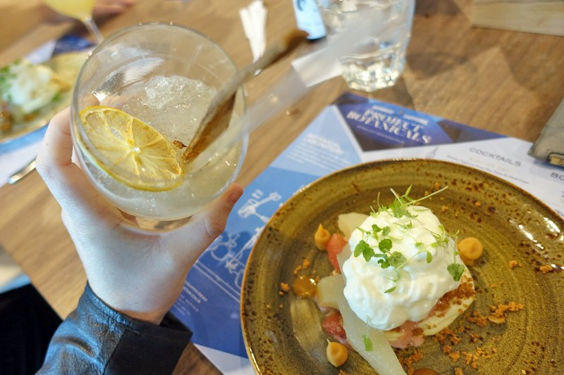 Fig and Cassia Swizzle cocktail with Poached pear with goats yoghurt foam & pink grapefruit